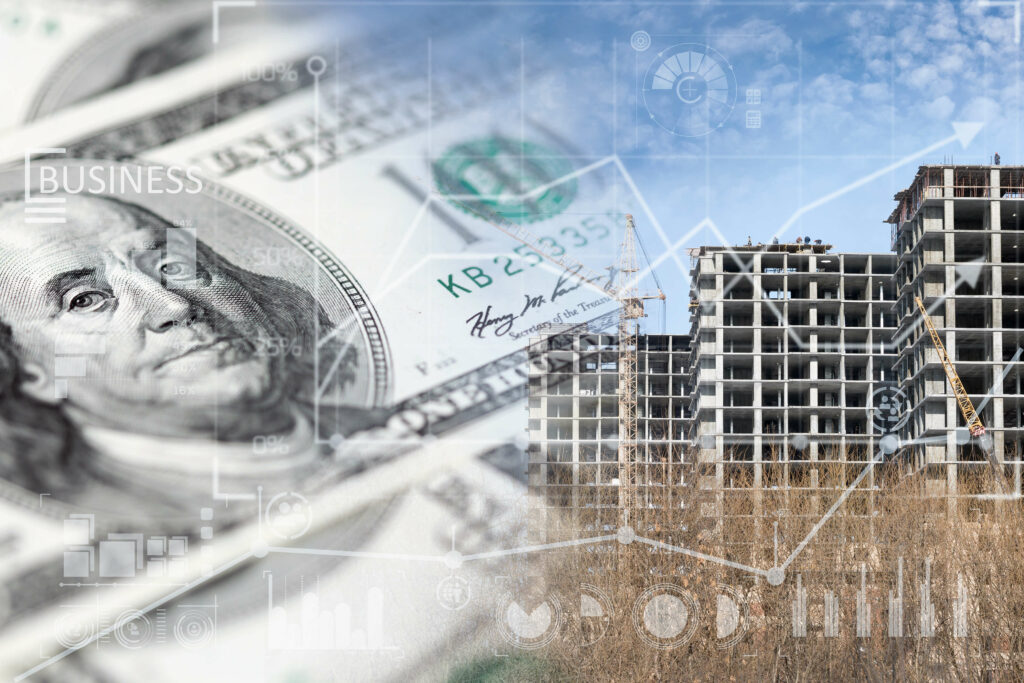 Image of money and an apartment complex under construction using SEO for marketing.